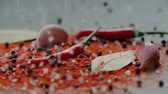 pimenta em grão : a mix of a lot of spices pours on the table in slow motion, ingredients for Asian cuisine dishes