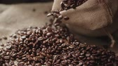 moka : human hands the farmer to touch high-quality coffee beans to scatter, bag jute, slow motion