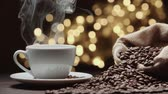 pano de saco : beautiful composition the Cup of hot coffee and coffee beans on the table, magic bokeh background