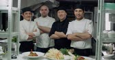 wok dishes : team of chefs Asian restaurant posing for the camera