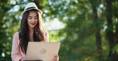 segregatory : young beautiful very emotional girl teenager with laptop in the park
