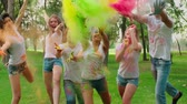 ručně malovaná : Multi-ethnic Group celebrate Holi festival in the Park , all in bright colours, look and shoot paint at camera in the Park, slow motion Dostupné videozáznamy