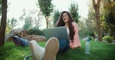 segregatory : young beautiful female student with a laptop in the park