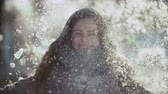 christmas angel : young woman enjoying winter day outdoors. snow winter dream. sunny winter day,slow motion