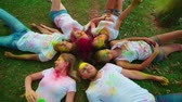 rave : company of young of different nationality friends having fun in the Park after the festival of paints Holi