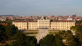 viyana : VIENNA - OCTOBER 06: Schonbrunn palace at sunset with tourists on October 06, 2012 in Vienna. Its a former imperial 1,441-room Rococo summer residence and one of the most important cultural monuments in the country.