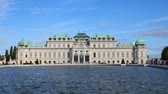 viyana : Belvedere palace exterior in Vienna, Austria on a sunny day Stok Video