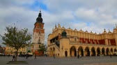 praça : KRAKOW, POLAND - OCTOBER 11: Old market square on October 11, 2012 in Krakow. Its a principal urban space located of the city and the largest medieval town square in Europe.