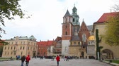 tégla : KRAKOW, POLAND - OCTOBER 11: Wawel Cathedral at Wawel Hill on October 11, 2012 in Krakow. The Wawel Cathedral has been the main burial site for Polish monarchs since the 14th century Stock mozgókép