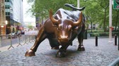 Charging Bull sculpture on May 12, 2013 in New York City. The sculpture is both a popular tourist destination which draws thousands of people a day, as well as one of the most iconic images of New York.