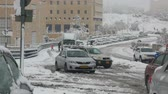 "okładka : JERUSALEM - DECEMBER 12: The cars stuck in snow due to a blizzard on December 12, 2013 in Jerusalem. The snow storm hit Israel was described by Channel 2 as the ""worst storm in decades"""