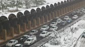 "kaygan : JERUSALEM - DECEMBER 12: The cars stuck in snow due to a blizzard on December 12, 2013 in Jerusalem. The snow storm hit Israel was described by Channel 2 as the ""worst storm in decades"" Stok Video"