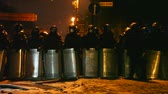 político : KIEV, UKRAINE - JANUARY 23: The riot police at Hrushevskogo street on January 23, 2014 in Kiev, Ukraine. The anti-governmental protests turned into violent clashes during last week.