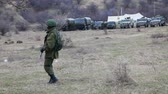 russo : PEREVALNE, UKRAINE - MARCH 4: Russian soldier guarding a naval base on March  4, 2014 in Perevalne, Crimea, Ukraine. On February 28, 2014 Russian military forces invaded Crimea peninsula. Stock Footage