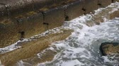 Surf wave crashes against concrete shore reinforcement, Close-up, Full HD - 60fps