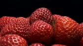 fragaria : Red strawberries on a black background. Close-up, Camera rotation 360 degrees. Stock Footage