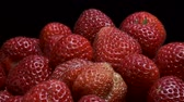 fragaria : Rotation of juicy strawberries on black background. Rotation 360 degrees, closeup. 4K - 50fps