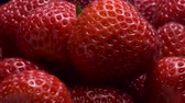 fragaria : Close-up of strawberries on black background. Rotation 360 degrees, Extreme close up. 4K - 50fps