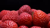 fragaria : Strawberries on black background. Rotation 360 degrees, closeup. 4K - 50fps Stock Footage