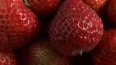 fragaria : Fresh ripe strawberries. Rotation 360 degrees, Top view, Extreme close up. 4K - 50fps