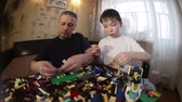 inventore : Father and son play LEGO. To work with children.The relationship of father and child.Educational games .