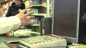 caixa : the cashier at the supermarket,