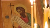芸術 : candles are burning on the background of icons in the Orthodox Church