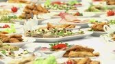 banquete : the Swedish table: meat, rice, pasta, salads and various cakes and pastries. Stock Footage