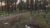 мусор : Garbage dump in a pine forest Стоковые видеозаписи
