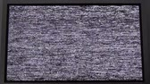 pixellated : Noise signal on the screen.Flickering analog TV signal with bad interference.