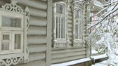 резной : Window of a wooden house. Branches of trees, covered with snow . Стоковые видеозаписи