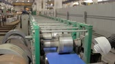 zinco : blue colored metal sheet is moving across machine 2 Stock Footage