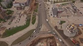 tube : copter flies down to building road junction in Samara city tilt up  1 Stock Footage