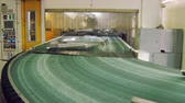 zinco : transporting tape with moving details of car body in automobile factory, making car body