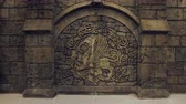 renesans : courtyard of medieval castle, amazing large bas-relief with coat of arms, brown stone walls