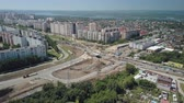 dormitory : camera flying over dormitory of big modern russian city, near construction of modern junction