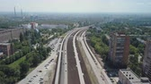 freeway interchange : aerial panorama of huge industrial city, large roads pipes of plant and factories in summer