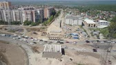 dormitory : large junction under construction, aerial view, difficult car traffic, sunny summer day Stock Footage