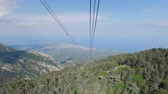 rolamento : view of Turkish Riviera in sunny clear weather from cabin of cable way on Tahtali Stock Footage