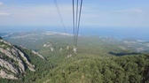 rolamento : good sunny weather on top of high mountain in Turkey, camera moves along cableway Stock Footage