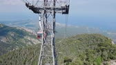 outing : camera moves along cable way on Tahtali in Turkey, view on seacoast, forest and rocks