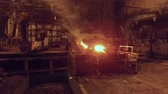 metallurgical industry : moving shot in foundry in metallurgical plant, open fire and red-hot metal in blast furnace