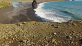 basalto : panorama from ground to landscape with ocean waves and rocks on a southern coastline of Iceland Stock Footage