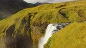 intocada : top view of waterfall on Skoga river in Iceland, top of Skogafoss, view in sunny day