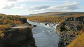 геология : canyon of Hvita river and view on picturesque waterfalls flowing through lava fields, Hraunfossar