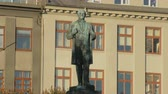 independence square : Reykjavik, Iceland - SEP, 2016: bronze monument of Jon Sigurdsson in background of windows in sunny weather