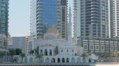 minarete : beautiful traditional mosque in Dubai near modern skyscrapers
