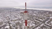 mikrofalówka : aerial view on tv tower in a large city near river in a winter day