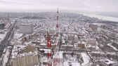 transmitir : around aerial flying shot of tv tower in winter day, Samara city
