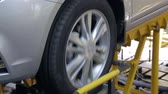 inspeção : car suspension test at automobile factory, close-up